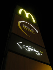 313/365: Capitalist monolith (Kelvin P. Coleman) Tags: canon powershot nottingham sign signboard food fastfood drivethru drivethrough urban night illuminated mcdonalds maccyds mcdo towering monolith 365 yellow lights hdr outdoor goldenarches