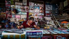 (Rob-Shanghai) Tags: news newsstand papers newspapers magazines shanghai china smoking people street leicaq