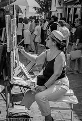 The Straw Hat (gwpics) Tags: female france painter paris french people streetphotography easel hat mono artist blackwhite blackandwhite film monochrome person socialcomment socialdocumentary society strasenfotograpfie bw lifestyle streetpics