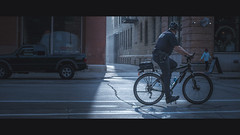 The arresting Light (R*Wozniak) Tags: cinematic color police street bike 16x9 widescreen light 235x1 graded nikond750 buildings backlit sun