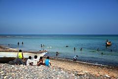 Port at fish market (indomitablemachine) Tags: hadiboh boat children ocean socotra yemen hadhramautgovernorate ye