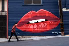 Rocky Horror on Bufano (Karen Carmen) Tags: man canon85mm sanfrancisco littleitaly street graffiti bluewall walking rockyhorror wall mouth lips red
