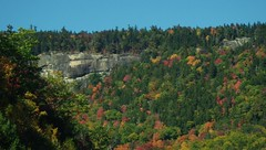 """This is the """"Gap Vista Scenery"""" along the Kanc - IMGP6609 (catchesthelight) Tags: northernnewengland nh nature mountains thekanc misspelled kangamangushighway kangamagushighway mustsee constructed 1959 traveled overamillionpeopleeachyear thekancamagushighway 34mileeastwestchannel 800000acre whitemountainnationalforest lincolnnhtoconwaynh trees change leaves summergreens breathtaking shadesofyellow red fall illuminated colorful dramatic enjoyable leafpeepingroute rockycliff"""