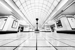 The Mother Ship. Gants Hill. (Sean Hartwell Photography) Tags: gantshill centralline londonunderground london undeground station trainstation tube tiles fisheye samyang8mm blackandwhite monochrome