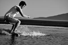 DSC_0130 (Travis Schuldt) Tags: blackandwhite beach water monochrome sport washington seaside movement sand outdoor pacificnorthwest pnw skimboarding bnw skimboard skimming belingham