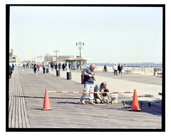 Coney Island NYC (D. McNamara Jr.) Tags: pentax67ii 200mmf4 mediumformat film kodak portra160 homedeveloped mediumformatfilm nyc brooklyn coneyisland topographic people street boardwalk