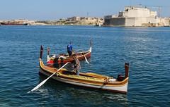 Maltese Boatmen (Lawrence OP) Tags: malta vittoriosa harbour sea boats