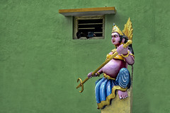 The Four Corner Female Guard with a Belly and Trident at Bangalore (Anoop Negi) Tags: green bangalore bengaluru lalbagh india karnataka hindu temple female icon iconography religion religious trident power shakti mariamman durga kaliamman demon goddess guard four corners anoop negi photo photography ezee123 yellow