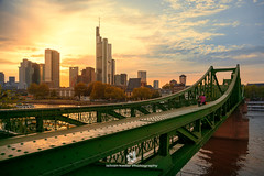 Eiserner Steg (fesign) Tags: atmosphericmood bridgemanmadestructure buildingexterior cityscape colourimage commerzbank dusk finance financeandeconomy frankfurtmain germany hesse horizontal lightnaturalphenomenon maintower moodysky office outdoors photography river rivermaingermany sky skyline sunset tallhigh tower