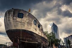 A Hard Rain's A-Gonna Fall (Gilderic Photography) Tags: liege belgium belgique belgie rain boat ship bateau tower architecture apocalypse city dark clouds sky gilderic 500d canon