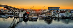 Risy, Haugesund - Norway (Vest der ute) Tags: g7x norway rogaland haugesund sunset seascape seaside sea reflections buildings bridge houses cranes boats fav25 cityscape fav200
