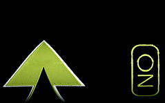 arrow on or oz [ in explore ] (flowrwolf) Tags: arrow macromondays mondaymacro hikingstick hikingstaff black green limegreen denalicarbonhikingstaff blackbackground shiny blackandgreen text flowrwolf macro makro minimalism greenarrow outdoor outside canon tokinalens