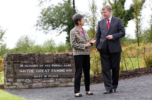 Chair of the Irvinestown Famine Graveyard Committee, Breege McCusker shows Social Development Minister Mervyn Storey, MLA around the Famine Graveyard in Irvinestown