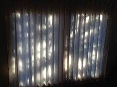 Drawn Curtains Backlit (Andrew Hidas) Tags: shadow backlight curtain filteredlight drawncurtains behindthecurtains