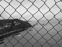 IMG_0069 (sadieellis) Tags: repetition fence sea