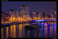 River Transport (Falcdragon) Tags: sonynex5 sonyzeisssonnarfe1855mmza river liege belgium night lastlight dusk lights reflection water city cityscape urban dark colour