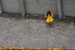Urban loneliness (Otaclio Rodrigues) Tags: mulher woman amarelo yellow vestido dress muro wall calada sidewalk urban streetphoto candid cidade city resende brasil oro topf25