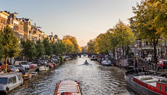 Amsterdam at sunset as the airplane is going in for landing (tessadventures) Tags: amsterdam netherlands sunset noordholland canals westerkerk grachtengordelwest boats boat cruise