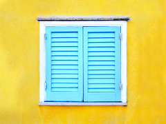 Vibrant cyan window frame in a yellow wall (Marco Crupi Visual Artist) Tags: yellow wall window home house residential exterior cottage texture shutter background sash residence plaster netcurtain pane pattern plastered plant sill windowsill holiday morning open frame surface old outdoor pastel