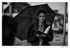 journalist in the rain (Alja Ani Tuna) Tags: 166 166365 365 woman girl rain umbrella notebook wet dry journalist 35mm 365challenge 365project photo365 project365 portrait portraitunlimited people onephotoaday onceaday d800 dailyphoto day street streetphotography bw blackandwhite black blackwhite beautiful monocrome monochrome working nikond800 nikkor nikkor85mm nice naturallight nature 85mmf18 f18