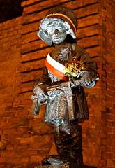 Poland-00686 - Little Insurrectionist (archer10 (Dennis) 85M Views) Tags: poland warsaw sony a6300 ilce6300 18200mm 1650mm mirrorless free freepicture archer10 dennis jarvis dennisgjarvis dennisjarvis iamcanadian novascotia canada submachine gun helmet child statue