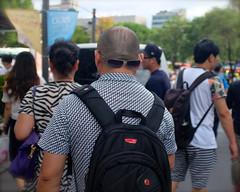 Unclear on the Concept of Sunglasses (Mondmann) Tags: street man sunglasses walking asia streetphotography korea seoul backwards southkorea rok backofhead eastasia myongdong republicofkorea unclearontheconcept mondmann fujifilmx100s