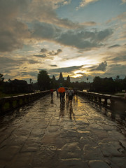 Crossing (D Song) Tags: travel blue sky playing heritage wet water rain silhouette architecture clouds sunrise children temple se boat jump rainbow ruins asia cambodia village olympus unesco ankor dslr wat flooded