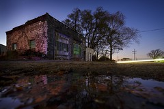 Abandoned Gas Station (Notley) Tags: longexposure november blue trees windows sky lightpainting reflection green fall abandoned leaves night facade rural puddle garage headlights gasstation missouri greenlight lighttrails nocturne bluelight lichtmalerei 2015 10thavenue notley ruralphotography notleyhawkins pinturadeluz   missouriphotography httpwwwnotleyhawkinscom notleyhawkinsphotography     chartitoncountymissouri