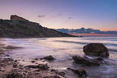 Ghajn Tuffieha Bay (glank27) Tags: sunset sea seascape beach canon landscape photography bay is movement mediterranean sandy rocky malta polarizer efs circular pro1 hoya tuffieha f3556 ghajn eos70d