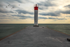 lighthouse (daniel_braga) Tags: longexposure winter sunset red bw lighthouse white toronto ontario canada bird water sunrise canon landscape long cityscape outdoor whitby ef bwfilter ndfilter 24105mm eflens 500px canont41