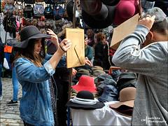 Buying hats (Melchita) Tags: streetphotography street streetcolor streetphotographycolor streetscenes streetportrait colorphotography urbanphotography urbanlife urbanscenes spain melchita