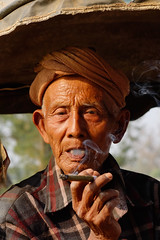 Old man smoking Burmese cheroot cigar (phuong.sg@gmail.com) Tags: boy burma burmese capital center centre chair cheroot cigar cigarette city developing down downtown easy elder face grey haired handmade homemade intense lazy life local man myanmar old poor portrait rangoon sat shirtless skin smoke smoker stool street tobacco town weathered wise wooden world wrinkled yangon