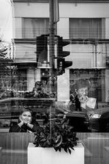 Smile (Pierre Pichot) Tags: black blackwhite blackandwhite child city cluj fuji fujifilm girl kid monochrome napoca outdoor portrait reflection romania shop smile street streetphotography streets symmetry urban white woman x100t