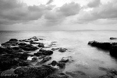 Lavernock Point (parry101) Tags: lavernock point sunset sunsets sky skies cloud clouds south wales sea seas water ocean long exposure exposures rocks seascape landscape landscapes seascapes coast shore le longexposure cardiff penarth sully blackandwhite monochrome outdoor rock formation