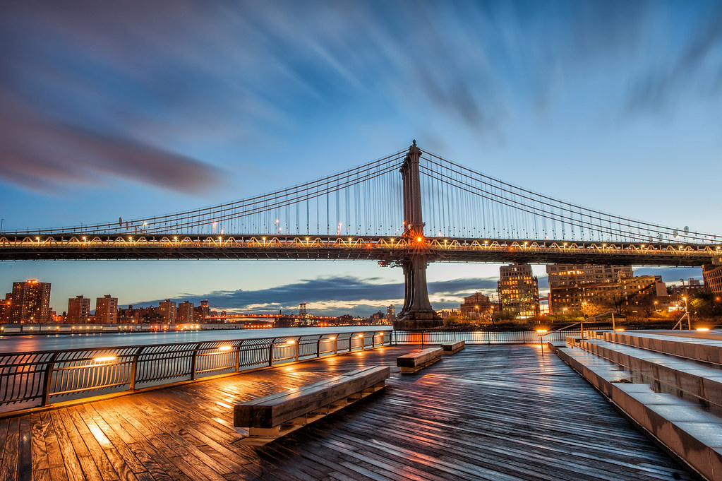 A long exposure of the Manhattan Bridge during a gorgeous sunrise in New York City.