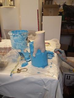 plaster hand emerging