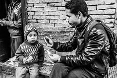 Father & son (Phg Voyager) Tags: street leica nepal people food photography eyes eating father son spoon explore katmandu m9 inexplore bhagtapur phgvoyager bagtapur