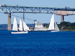 Sailing By (ironmike9) Tags: ocean bridge sea lighthouse water sailboat bay coast boat seaside ship vessel maritime sail nautical suspensionbridge schooner sloop newportri newportbridge roseislandlighthouse