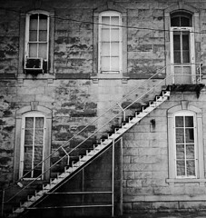 Moving Day (torn8o) Tags: canoneos3 kodaktrix kansas stairs stairway oldbuilding aged homedeveloped