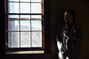 Woman by a Window No. 1 (Geoffrey Coelho Photography) Tags: portrait female woman girl winter farm farmouse dark lowkey window desolate abandoned somber mood moody wyeth wyethesque