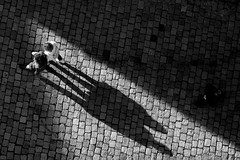 four legs, two heads (Wackelaugen) Tags: shadow people street person couple light pov pavement cobbles cobblestones canon eos photo photography wackelaugen googlies black white bw blackwhite blackandwhite mono tbingen germany europe