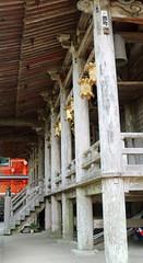 Nachi Grand Shrine 10 (Geoff Buck) Tags: japan shrine sacred buddhism buddhist temple buidling tree kumanokodo kumano nachi nachisan shinto worldheritagesite pilgrim pilgrimroute history worship statue statues carvings flags altar