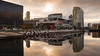 Sunrise (samiKoo) Tags: docklands melbourne melbournearchitecture australia victoria water reflection reflections architecture etihadstadium buildings building sky clouds sun sunrise morning sunlight photography photo photograph city cityscape cityview urban canon 6d