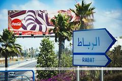 Coca Cola billboard in Rabat, Morocco (Naomi Rahim (thanks for 4 million visits)) Tags: rabat morocco africa northafrica 2016 travel travelphotography nikon nikond7200 wanderlust summer bluesky street streetphotography advertising billboard ad cocacola coke sign palmtrees arabic