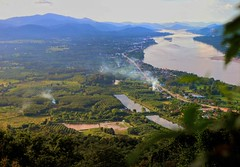 Mekong Valley (Colin Kavanagh) Tags: laos thailand thai wat nongkhai river valley landscape sky mountains trees green water smoke roads lake nature scenic scenery view viewing point