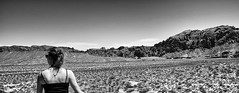 Miles to Go (evanffitzer) Tags: lasvegas desert valleyoffire alone vista bw blackandwhite mono panorama fujifilmx100s girl mountains desolate dark hot nevada evanfitzer evanffitzer miles small landscape distance
