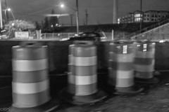 Traffic barrels. Day 334 (RPStrick) Tags: traffic barrels jersey wall median dark bands bw