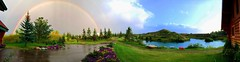 Pano: Double rainbow after a violent rainstorm (peggyhr) Tags: peggyhr panorama doublerainbow rain bluebirdestates alberta canada canoe red lake hills trees summergarden clouds sky blue orange green white brown boats flowers yellow img6639y appleiphone6 thegalaxy thelooklevel1red ♣myhatsofftoyou ♣mothernature thelooklevel2yellow 50faves thegalaxyhalloffame thelooklevel3orange rainbowofnaturelevel1red rainbowofnaturelevel2orange 500viewsatleast rainbowofnaturelevel3yellow carolinasfarmfriends rainbowofnaturelevel4green