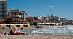beach landscape (Fer Gonzalez 2.8) Tags: leica city sea woman beach buildings sand alicante laperla leicadlux4 nopublicbeach