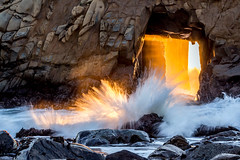 Portal Explosion, Big Sur, CA (Rod Heywood) Tags: ocean california light sunset sun beach yellow coast rocks surf glow arch crash scenic bigsur dramatic wave spray shore portal moment splash sunlit keyhole drama seashore pfeiffer pfeifferbeach sunsrays keyholearch keyholerock
